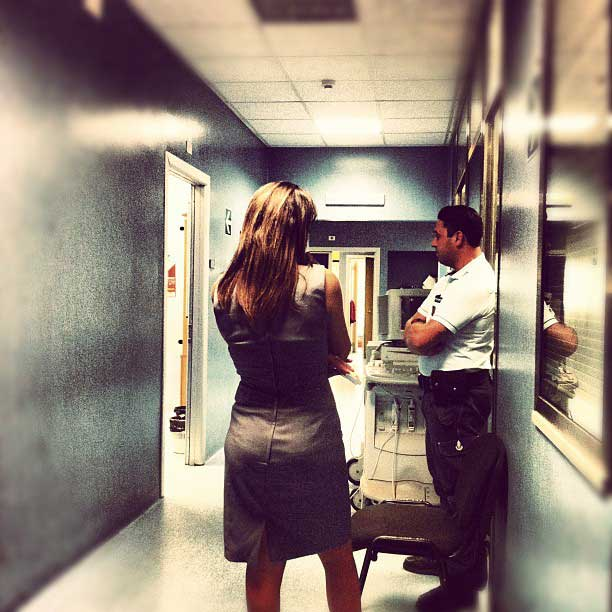 Couple at the hospital waiting in hall